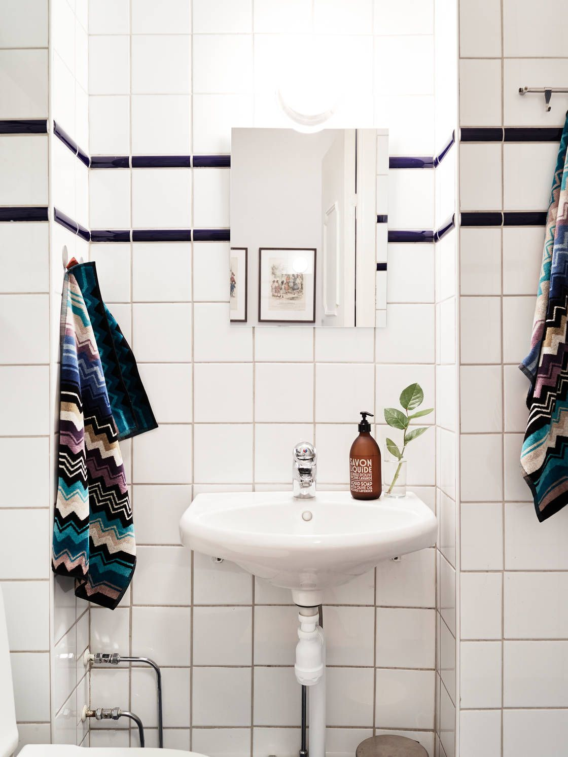 clean and bright. bathroom. zig zag towels. subway tile. black and ...