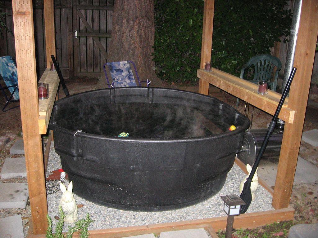 A wood fired stock tank hot tub alternative energy