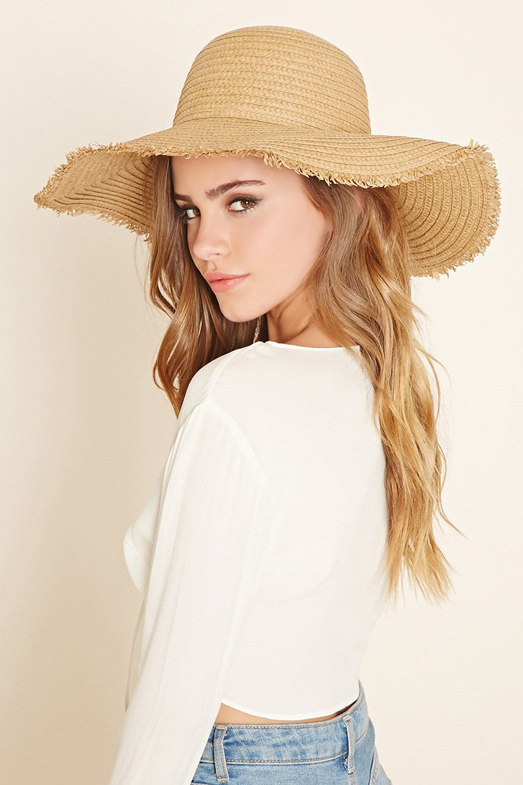 16ac5f6b A straw hat featuring a floppy wide brim with frayed ends ...