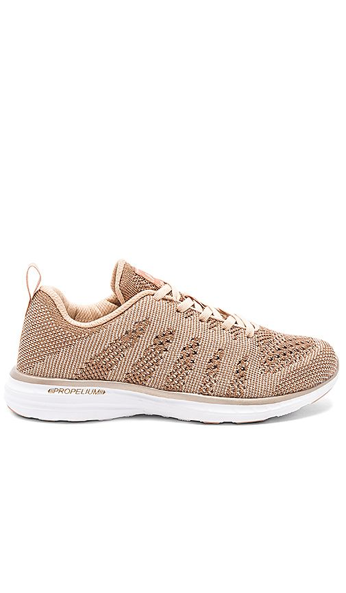 ace1b5165c13 Shop for Athletic Propulsion Labs  APL TechLoom Pro Sneaker in Rose Gold    Parchment at REVOLVE. Free 2-3 day shipping and returns