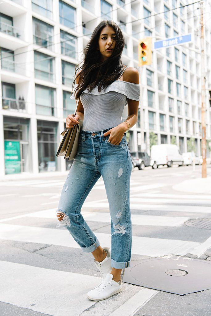 Wear an off the shoulder bodysuit with boyfriend jeans and sneakers for an off-duty casual vibe ...