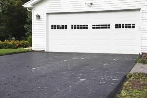 """Seal Your Driveway And Return It To """"Just Paved"""" Glory: Newly Sealed Asphalt Driveway"""