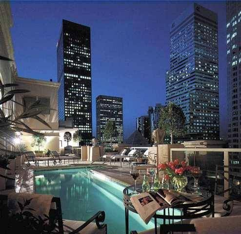 Enjoy A Gl Of Wine By The Rooftop Pool Hilton Checkers Los Angeles