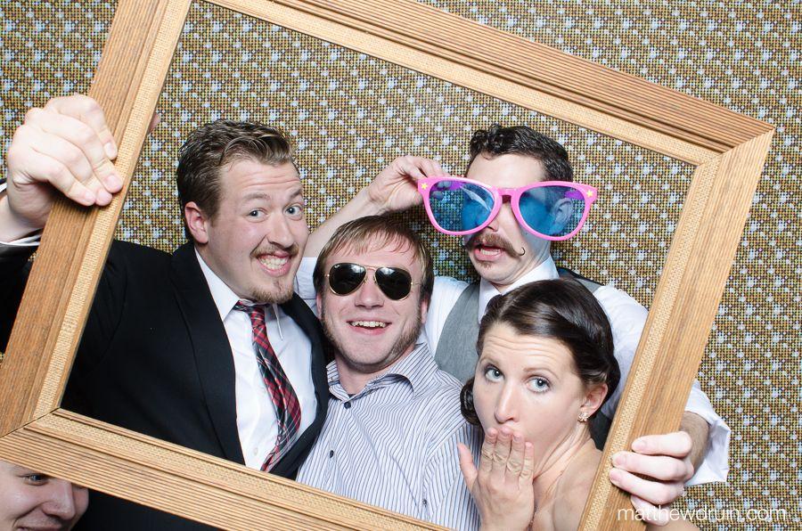Wedding guests framed in Atlanta wedding photo booth.    Atlanta based Wedding Photographer Matthew Druin - www.matthewdruin.com