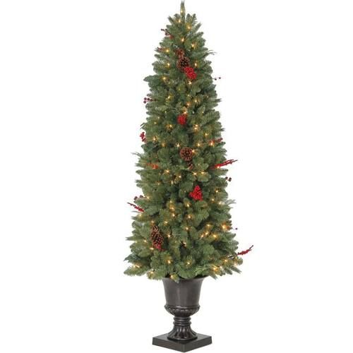 Seated In A Beautiful Decorative Pot And Illuminated With 200 Clear Incandescent Lights This Versatile Tre Potted Christmas Trees Christmas Tree Holiday Decor
