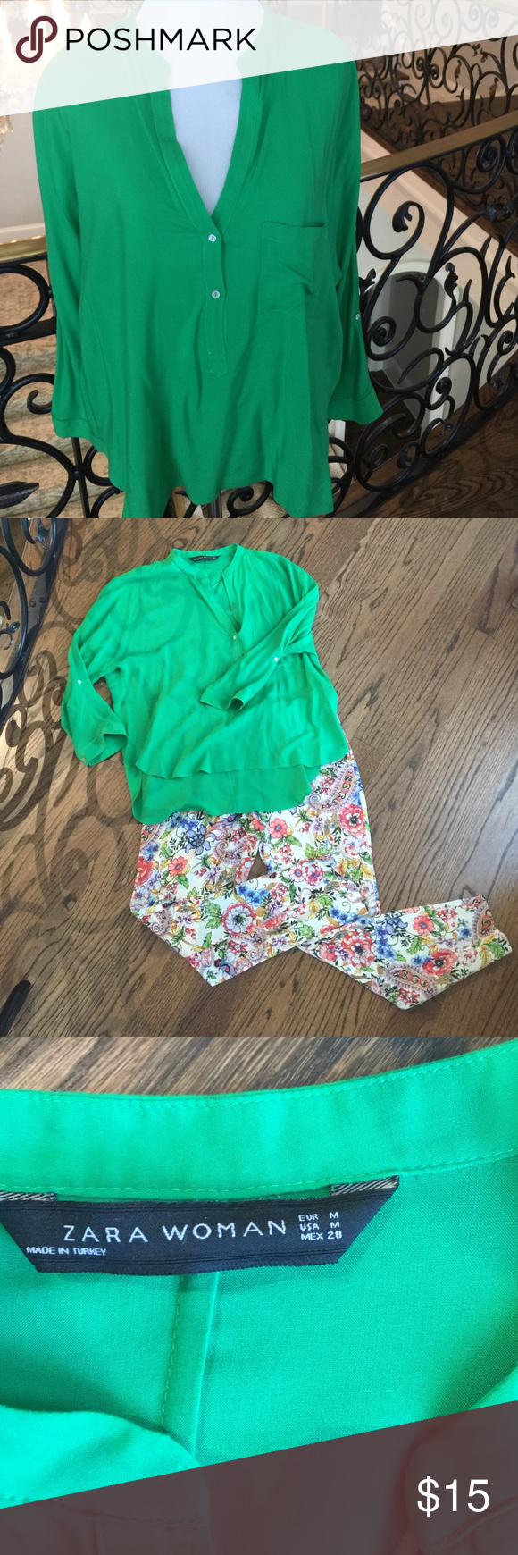 Zara bright green top This blouse buttons half way down. Has buttons on the sleeve to roll up and cinch. Slightly longer in back. EUC. Bought at the Zara in Florence. Zara Tops Blouses