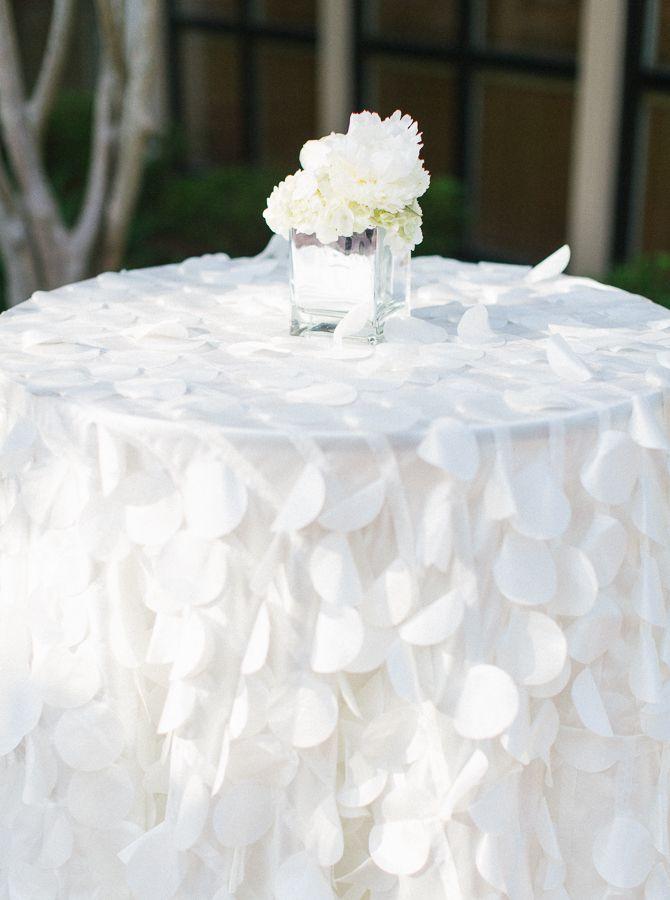 unique white wedding tablecloths http://www.weddingchicks.com/2013/10/09/elegant-southern-wedding/