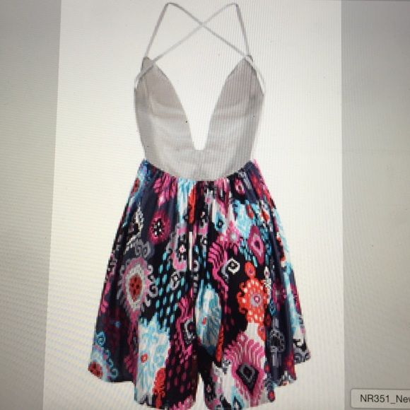 ✅✅NEW SIZE✅✅sexy girly flirty romper size M Sexy flirty girly romper. White lace top with Racerback spaghetti straps, plunging front neckline. Multicolored print bottom. Size M: 80-82cm length, 70-72cm waist, 90-94cm bust. NWT Dresses Backless