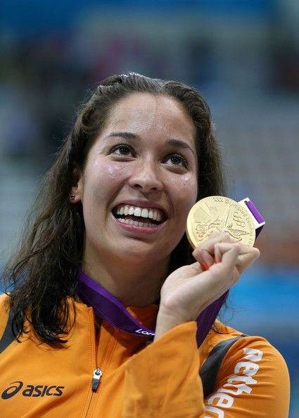 Gold medallist Ranomi Kromowidjojo of the Netherlands celebrates with the medal won in the Women's 100m Freestyle Final (Ezra Shaw/Getty Images Europe) tumblr.com