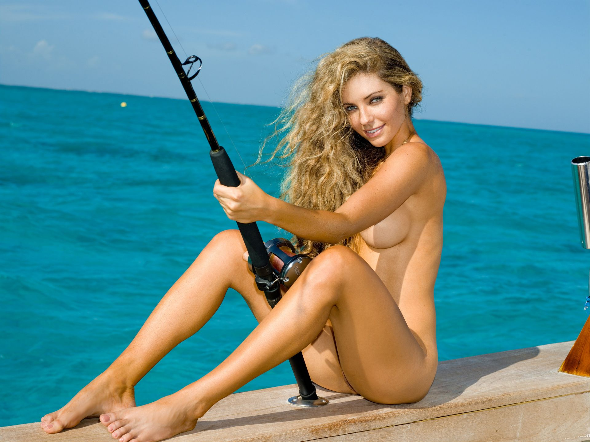 Naked blonde fishing, and swollen clit
