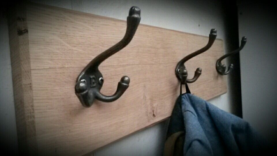 Country crafts coat hook board, initialed iron acorn hooks on a waxed oak board