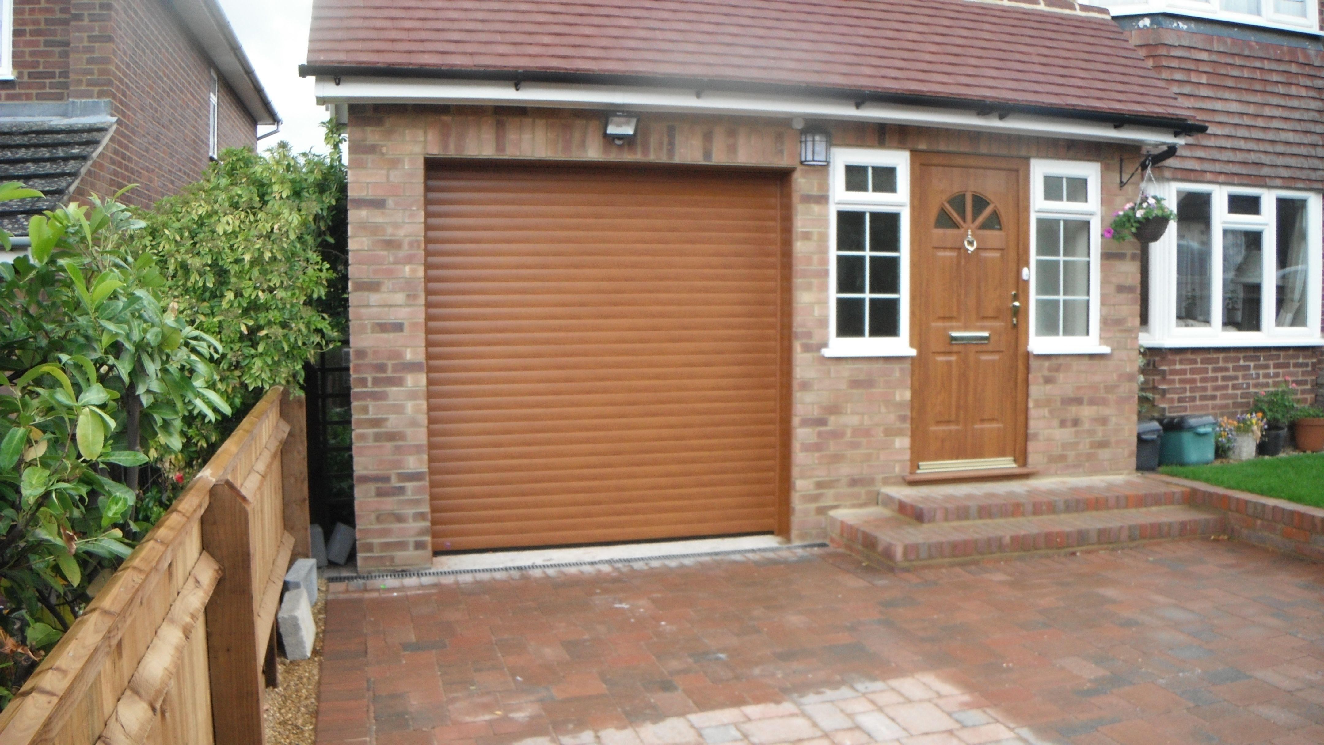 Hormann rollmatic garage door in golden oak decograin for Garage door finishes