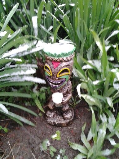 Occasionally it snows during the spring in Nebraska. My peace solar tiki dude doesn't seem to mind his beer being a tad frosty though.