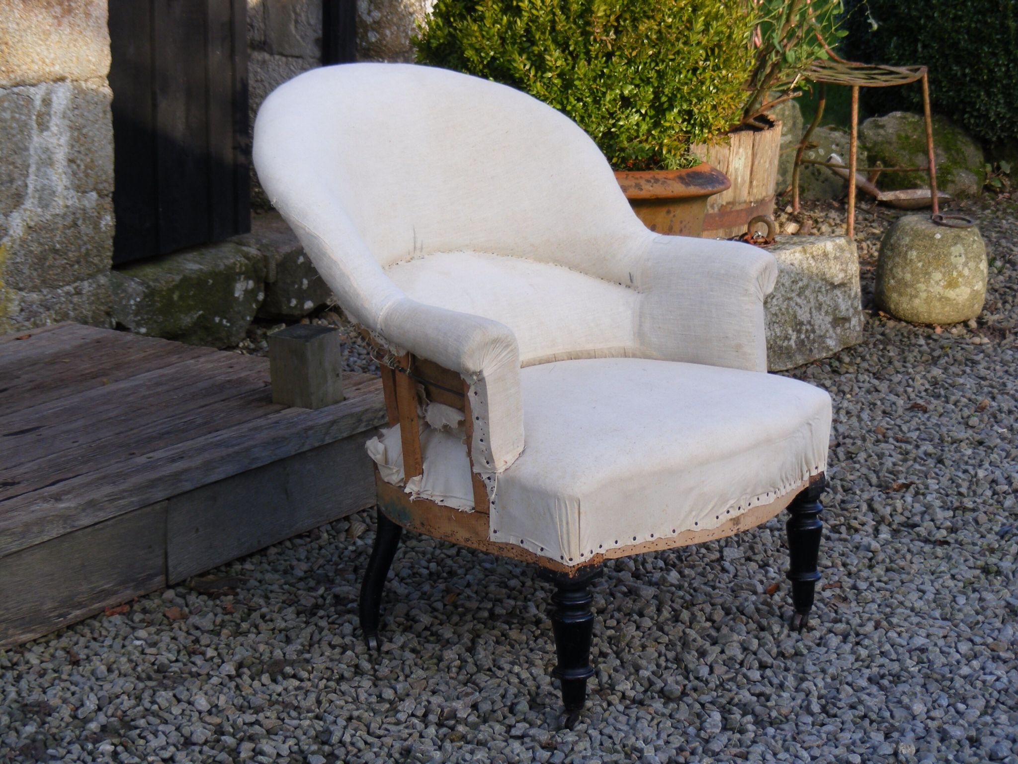 An Early To Mid 19th Century Tub Chair Covered In Calico With Casters.  Height   81cm Width   72cm Depth Of Seat   47cm. SOLD
