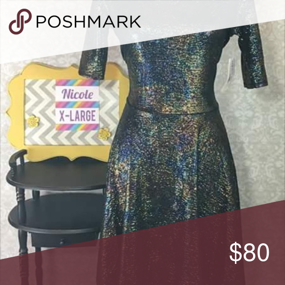 Lularoe elegant collection 2016 Nicole dress Beautiful elegant collection Nicole style dress; breathtaking mermaid print! I feel like it would fit more of a large. Rare print with each one extremely limited. Will not accept low offers. LuLaRoe Dresses Midi