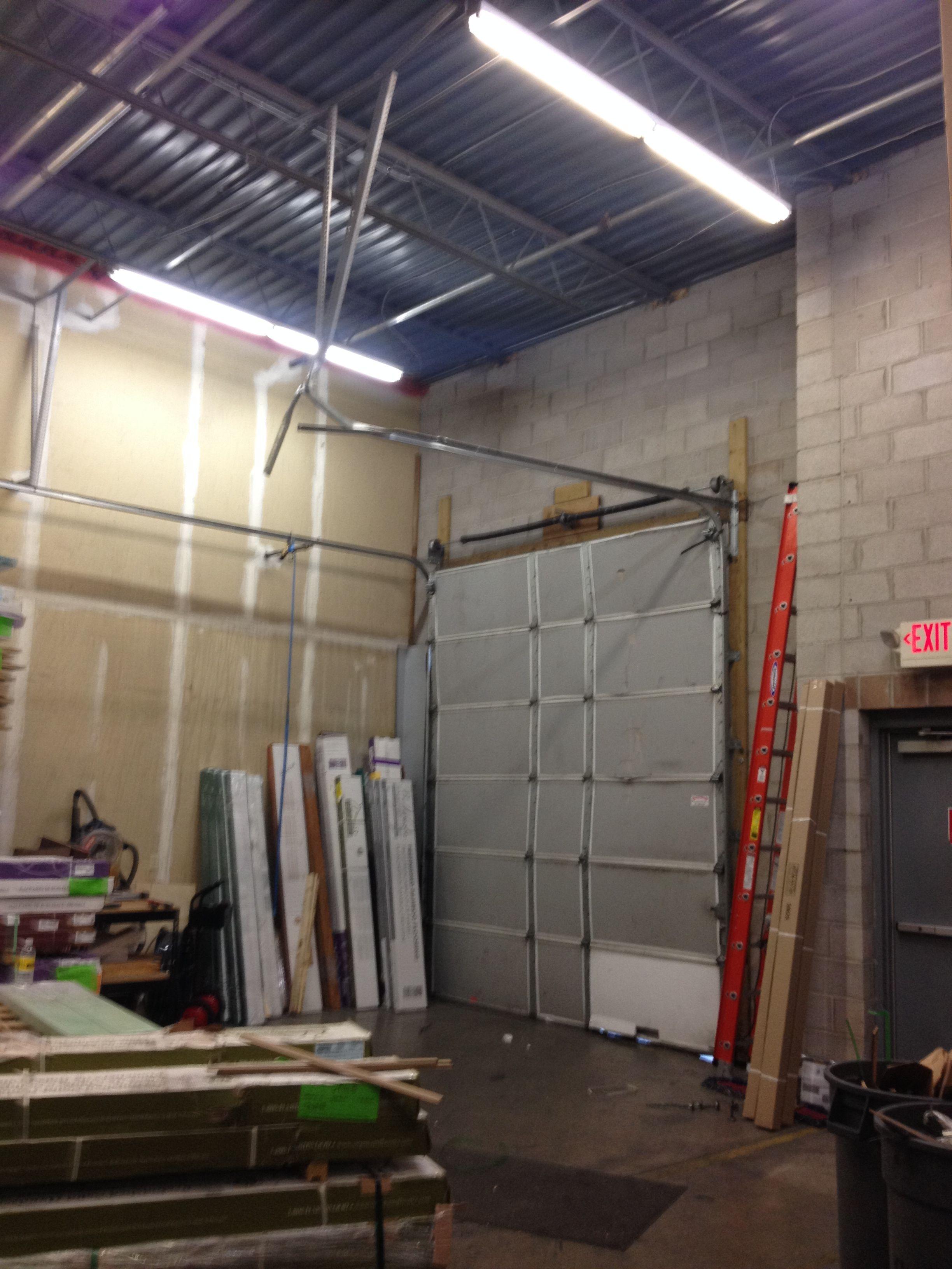 broken gothic cost door repair carriage classy doors on to fix garage replace spring wood
