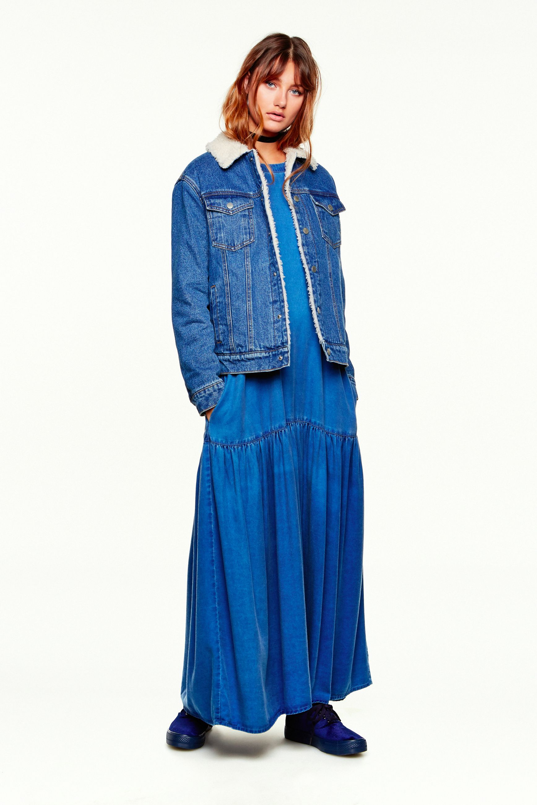 A denim jacket with faux fur lining over a maxi dress from the CASTRO Jeans Symphony collection