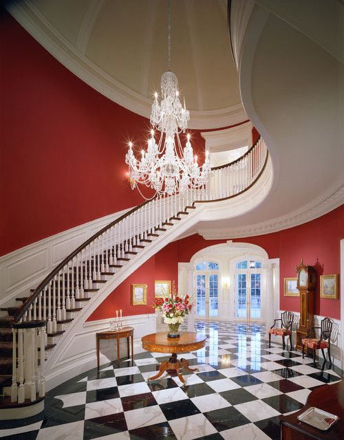 Red Walls Curved Staircase White Wainscoting Black And White