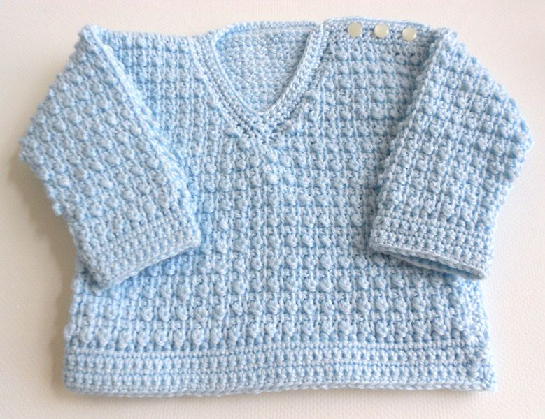 A while back I saw a pretty little baby boy sweater that was done in ...