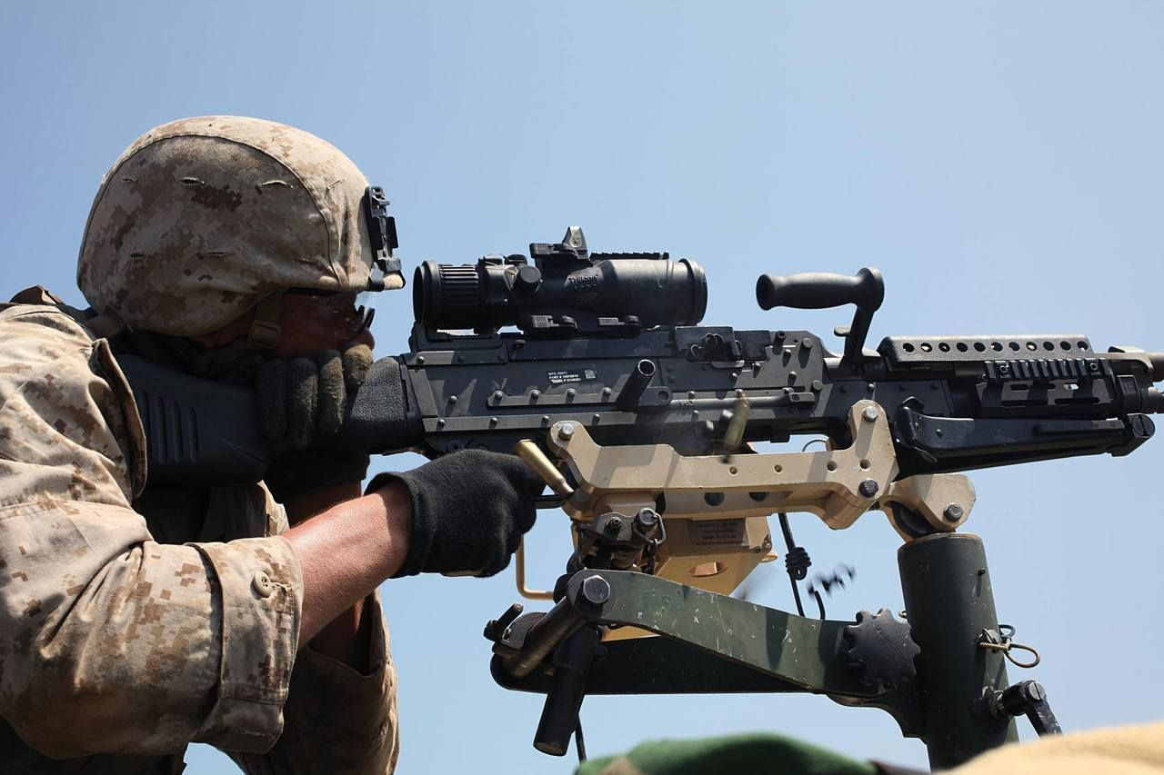 Marines with a mounted M240G  The optic is a Trijicon ACOG