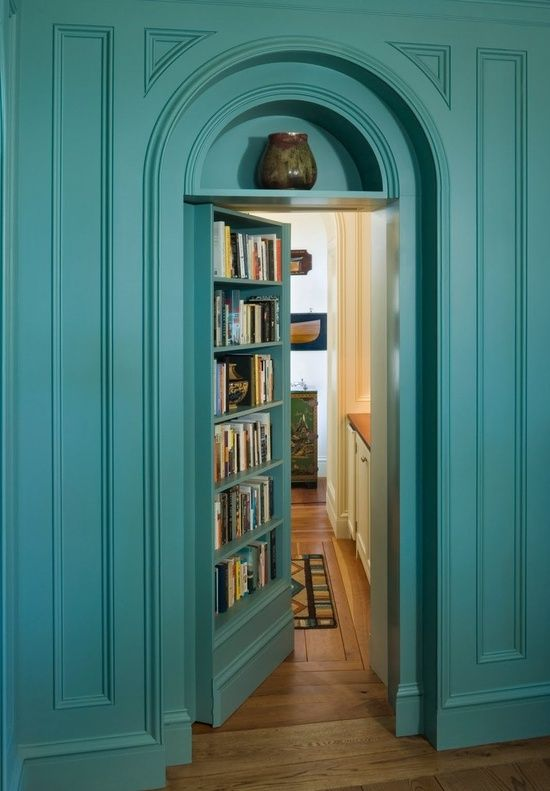 Secret Door To Hidden Room! Teal Blue Walls And Arched Secret Door Opens To  Hidden Room. Faux Bookcase Opens To Secret Room.