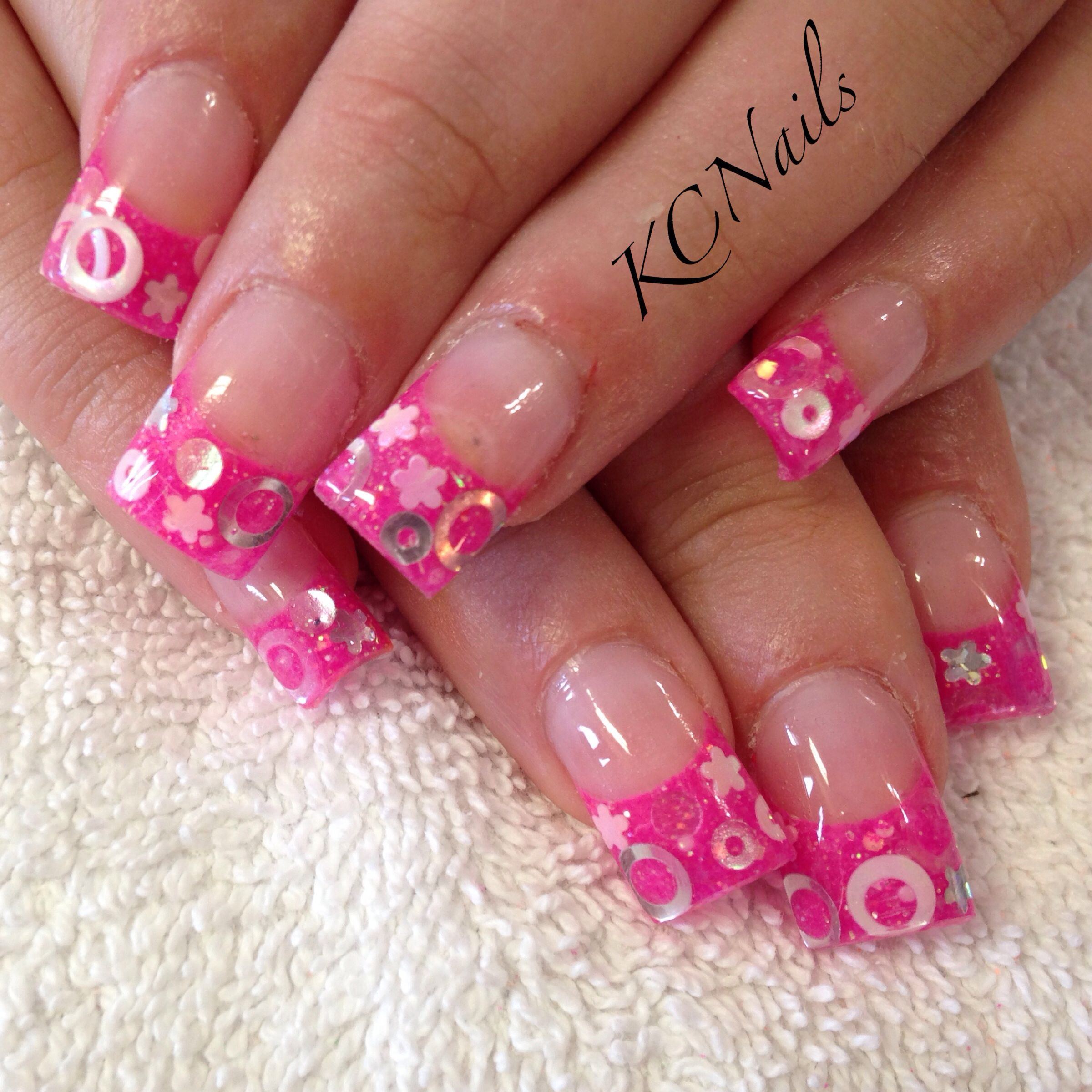 hot pink acrylic nails french tip with circle and flower