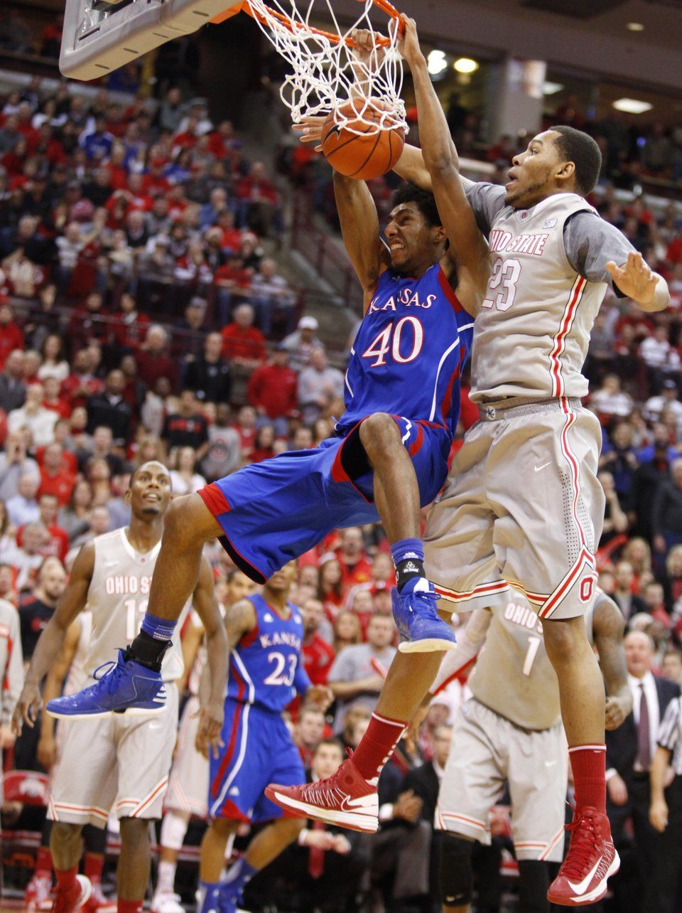 Kansas forward Kevin Young finishes a dunk and gets a foul
