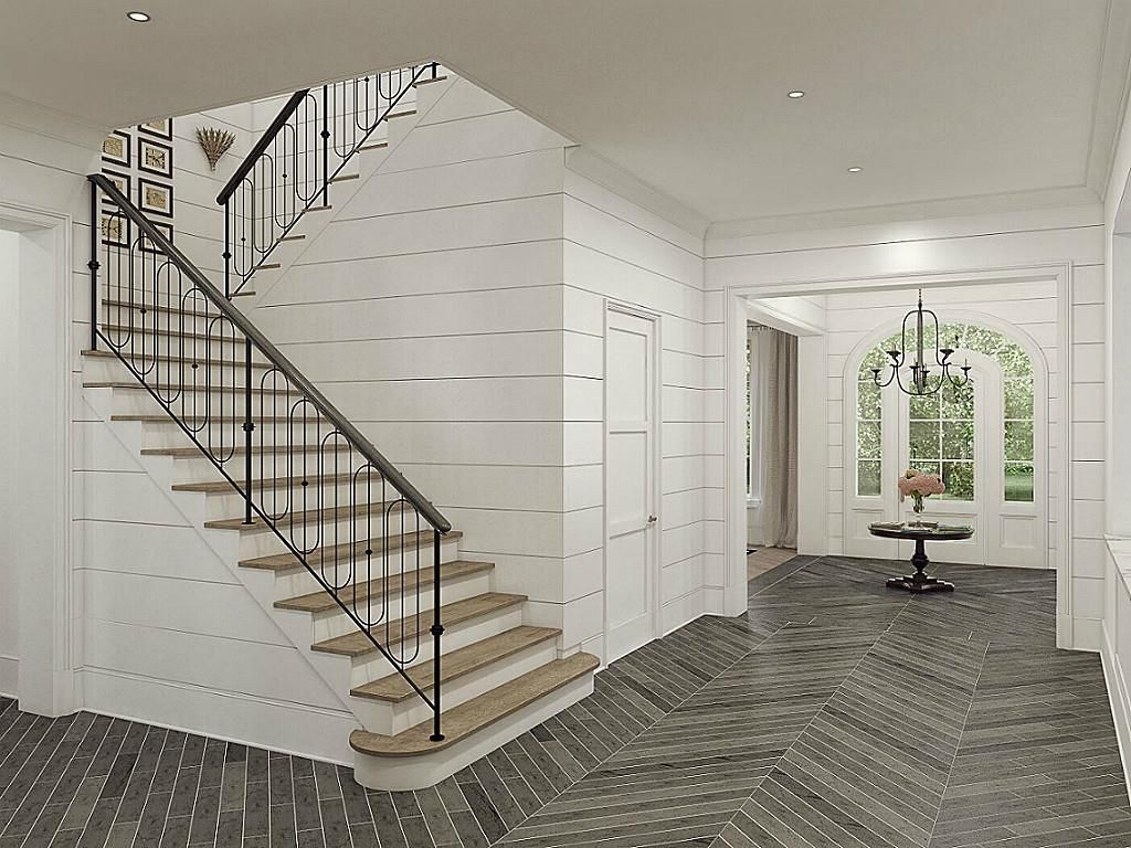 french country home with ship lap foyer and stairwell planked