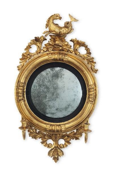 A PAIR OF REGENCY GILTWOOD CONVEX MIRRORS EARLY 19TH CENTURY 32 in. (81.3 cm.) high; 18 1/2 in. (47 cm.) wide