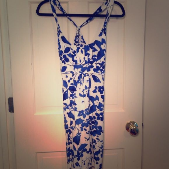 Floral sundress Really soft jersey material. The front features pleating on the chest. Racerback straps and it ties in the back. The material is a bit worn but it's still incredibly soft and looks great American Eagle Outfitters Dresses Midi