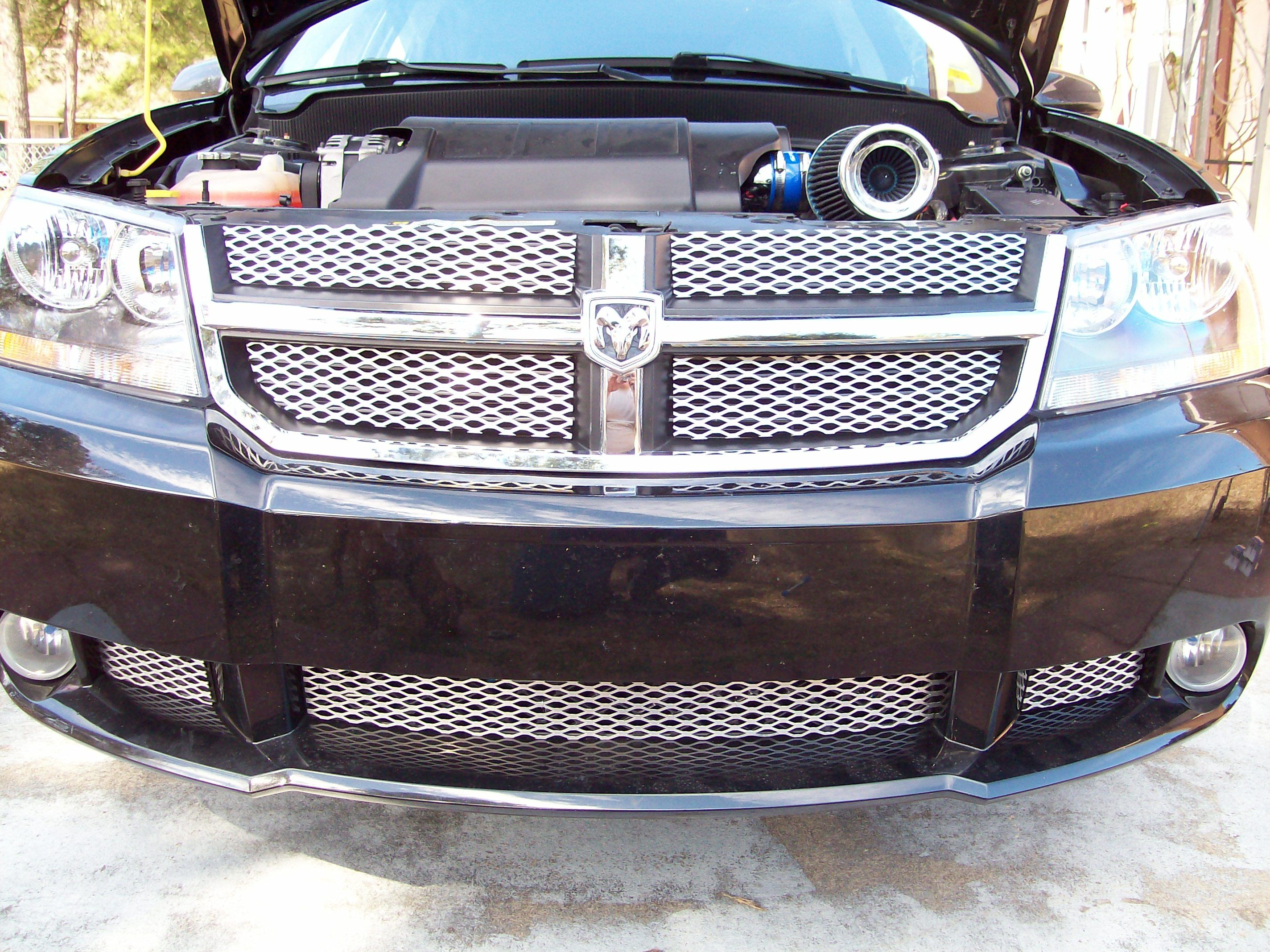 Dodge avenger with expanded aluminum grille overlay