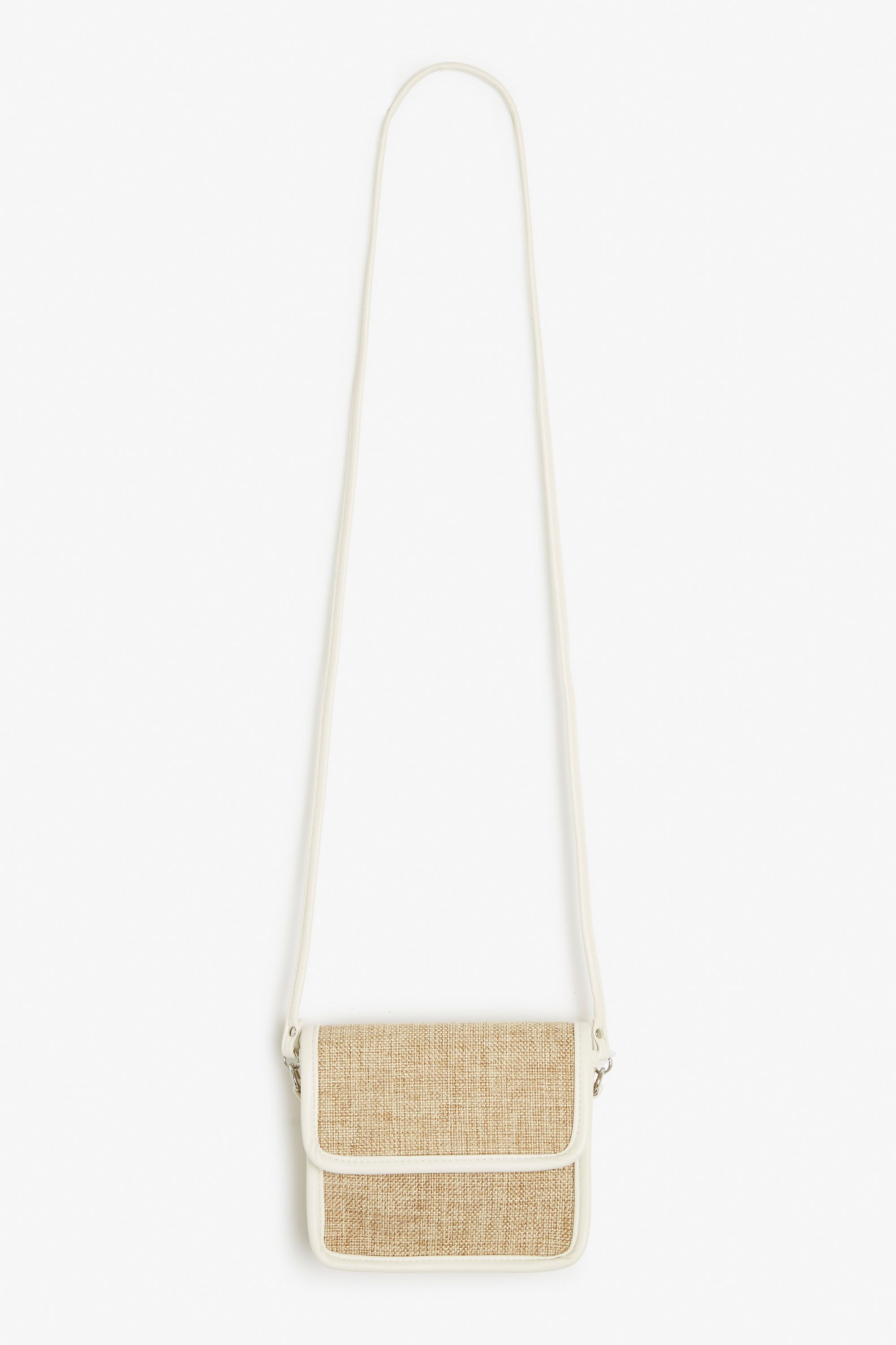 A petite sized, long strap purse that's begging to go on your beach vacay.