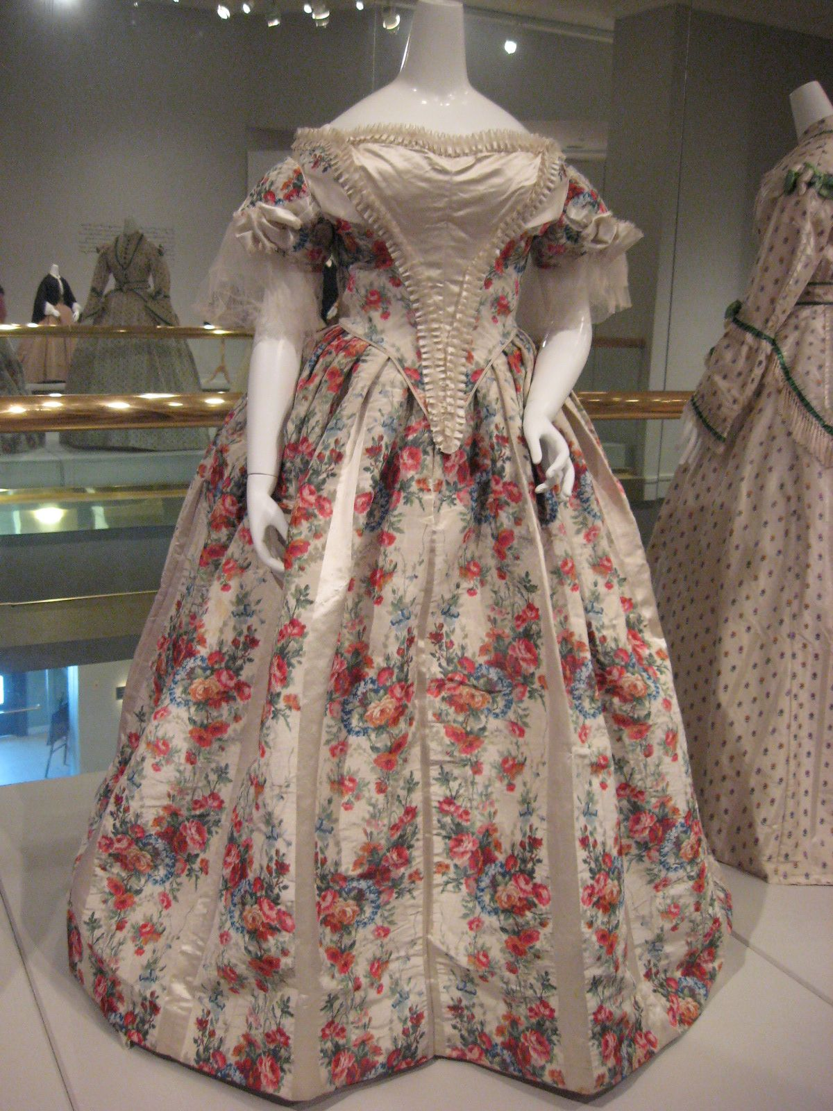KSMF -  Ivory silk evening gown with warp printed flowers, circa 1860.