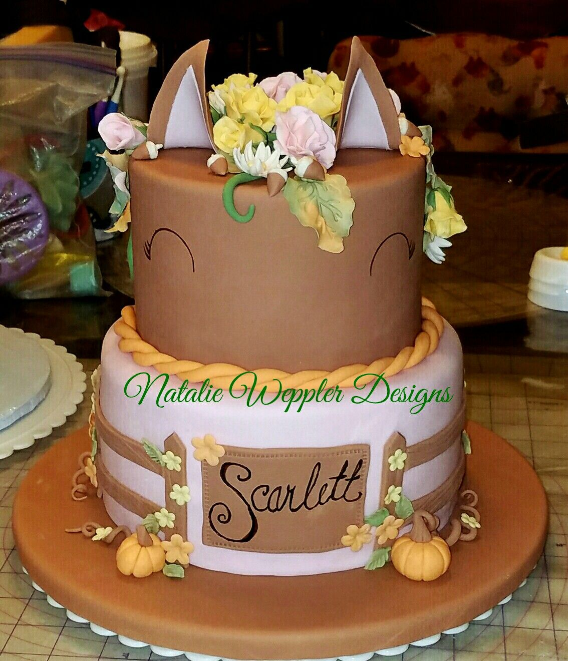 This horse riding barnyard themed birthday cake has a pastel fall
