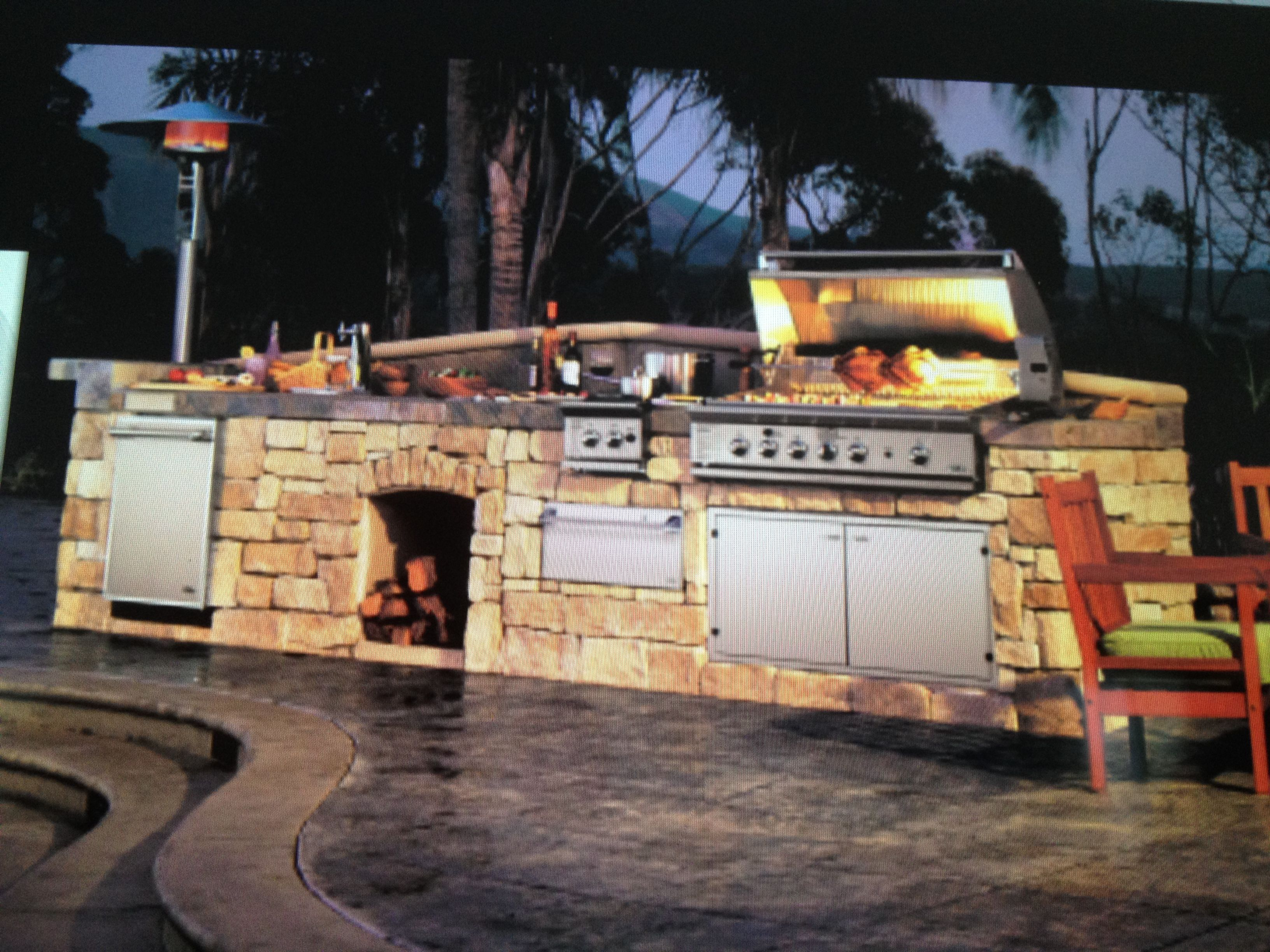 Built in grill with prep space on either side of grill and burner