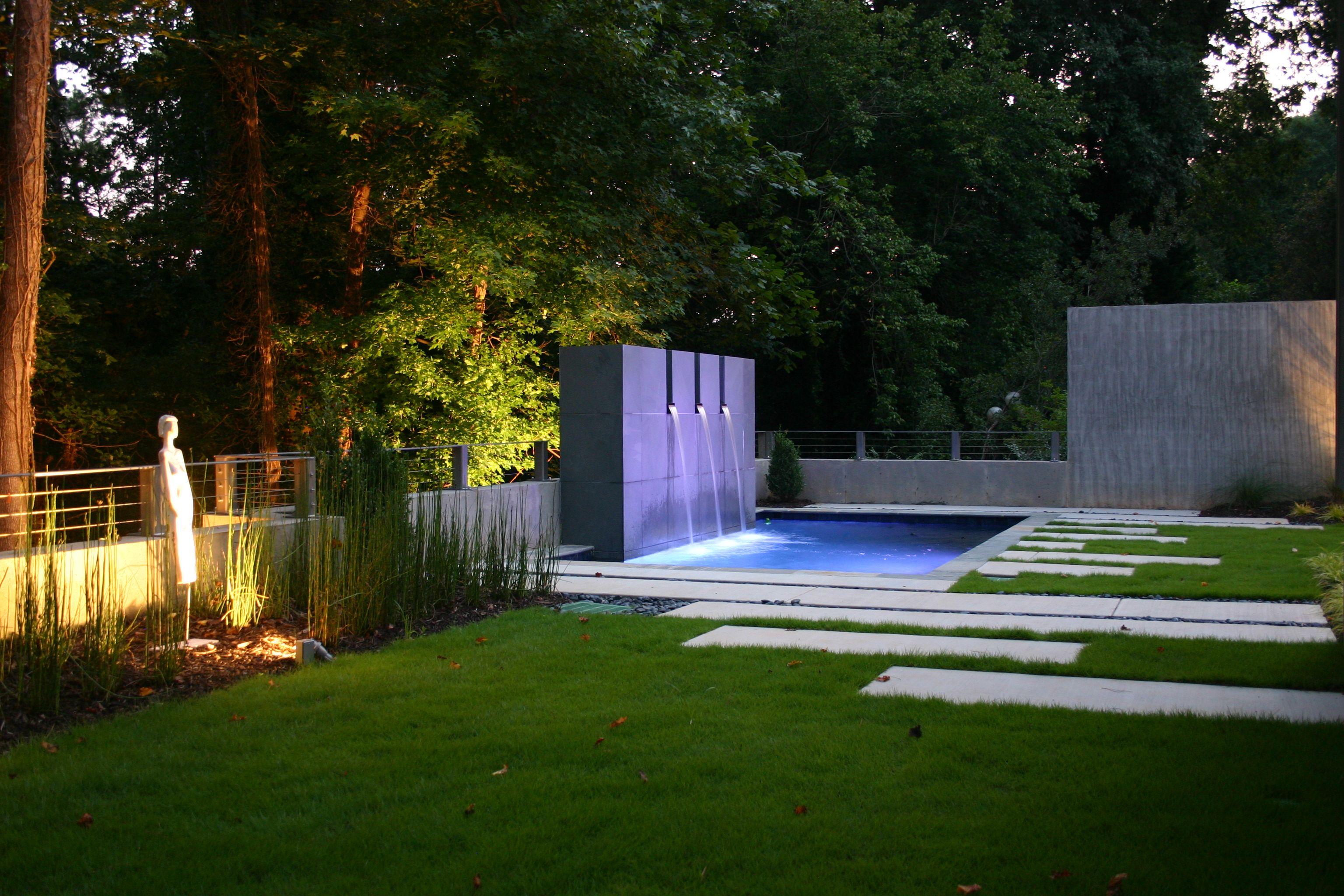 metro atlanta home with a modern backyard swimming pool design