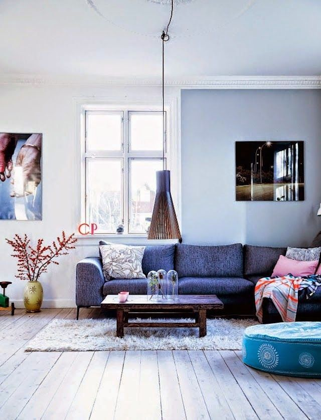 Blue living room with a pendant from Secto Design via My Scandinavian Home.