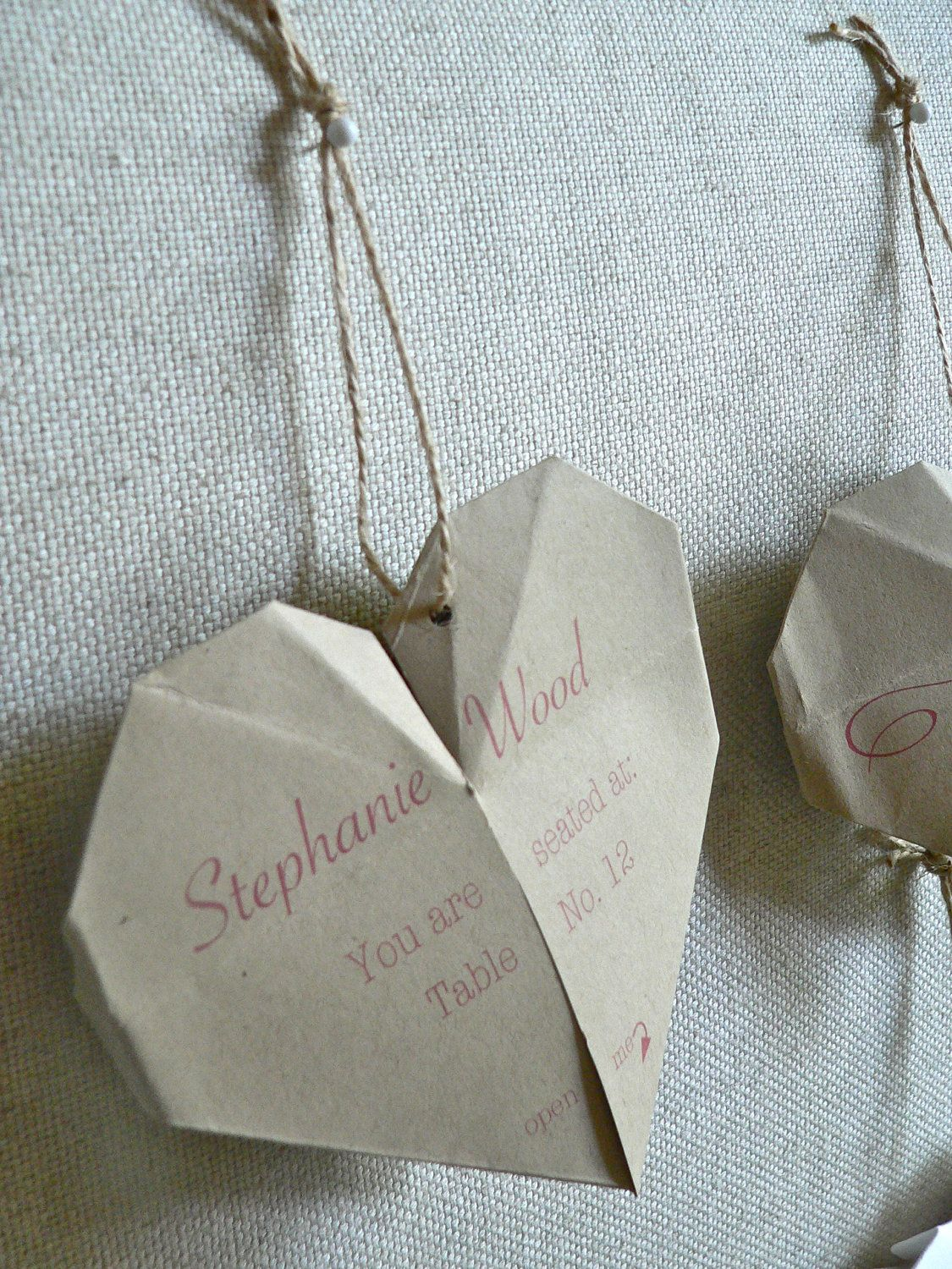 Origami Heart Wedding Escort Cards with Special Message to Guests on Inside - set of 50. $60.00, via Etsy.
