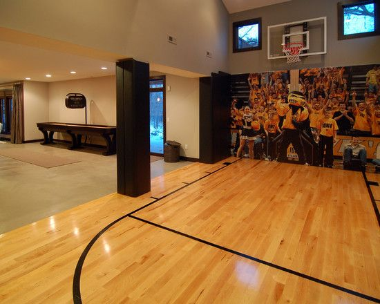Basketball court added to this Man Cave.  Beautiful Maple hardwood floors!
