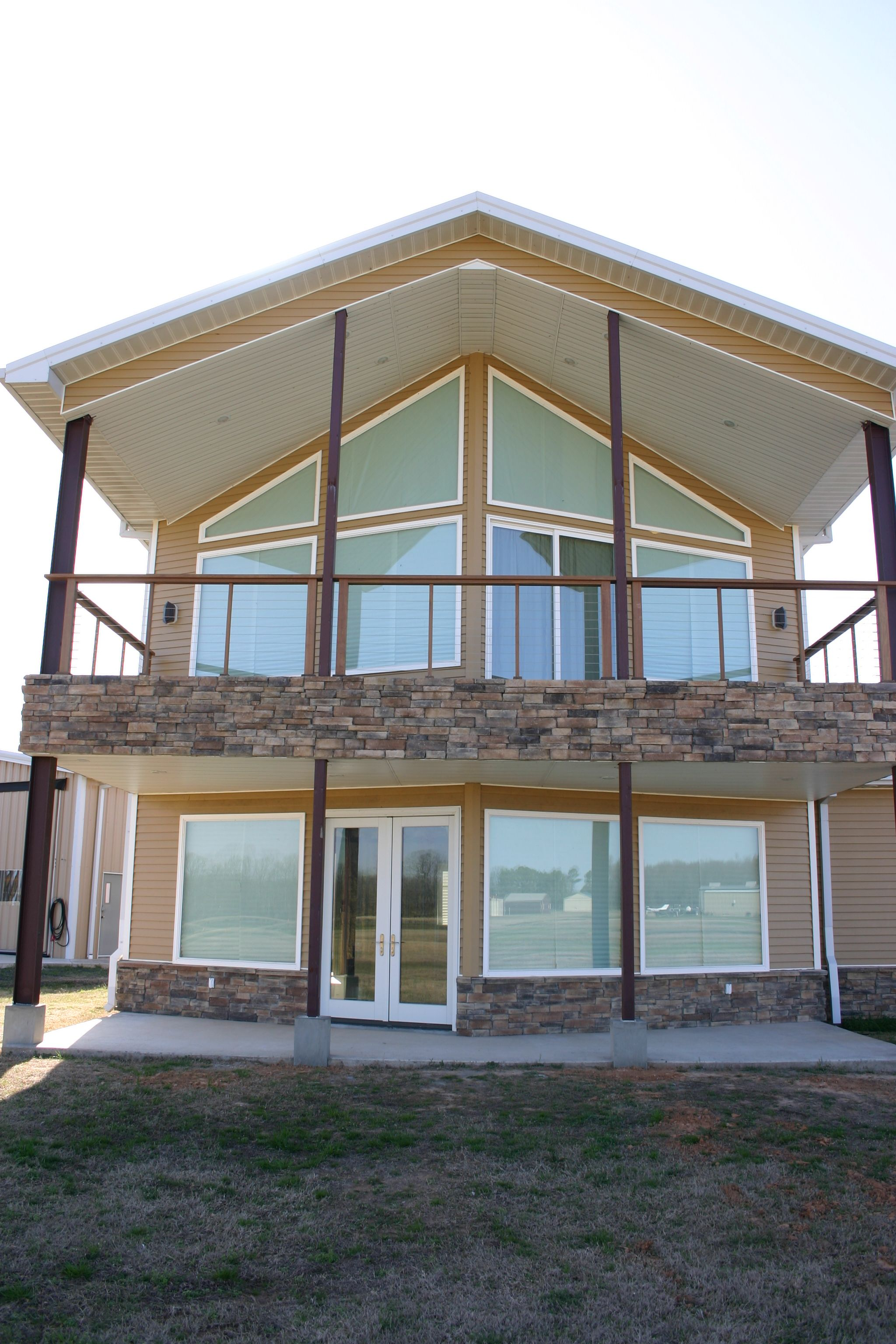 Elegant HouseAspen With Modifications Handsome Utilization Of Red Iron Steel . Steel  Home Designs. Modern Home