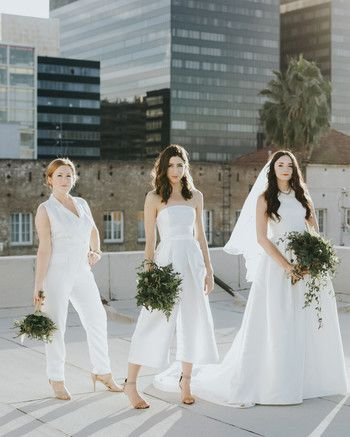 20 Wedding Parties That Prove Bridesmaids' Jumpsuits Are Just as Beautiful as Dresses #bridesmaidjumpsuits women posing on roof wearing white bridesmaids jumpsuits #bridesmaidjumpsuits