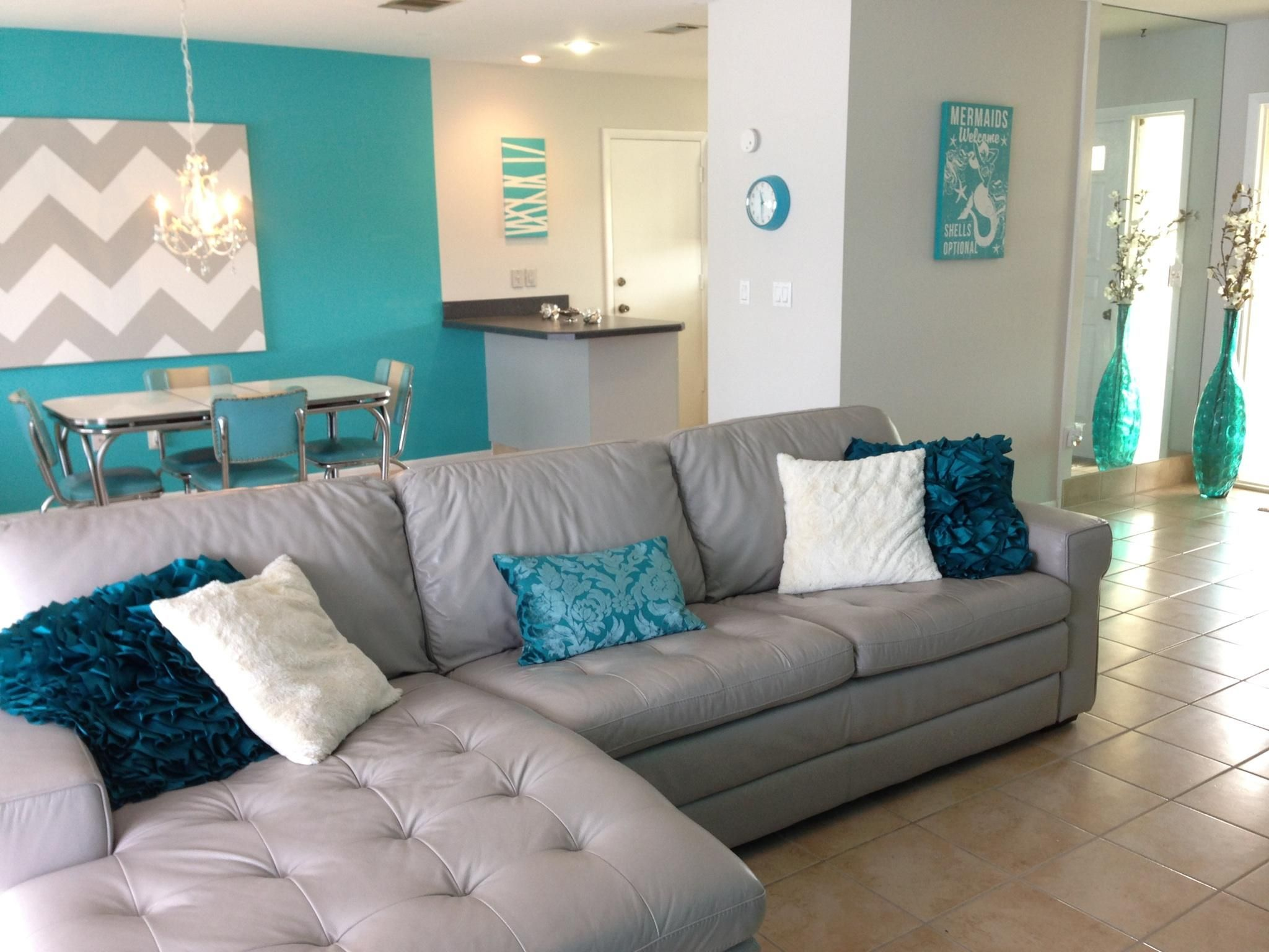 Florida home Beach house Leather couch Homemade art Tan and teal