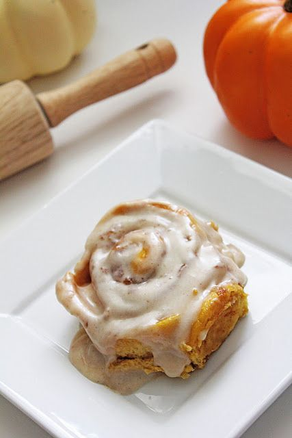 Pumpkin cinnamon rolls with cream cheese frosting.