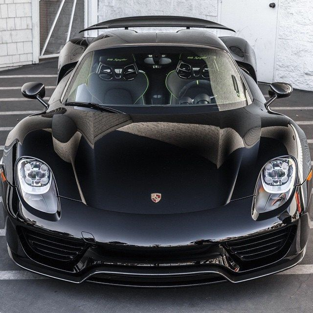 porsche 918 spyder in jet black with lime green trim is humbly waiting to be driven