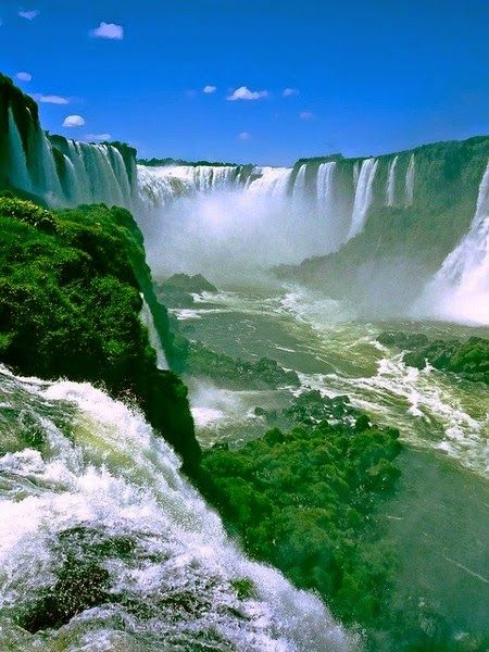 The falls divide the river into the upper and lower Iguazu. The Iguazu River rises near the city of Curitiba.