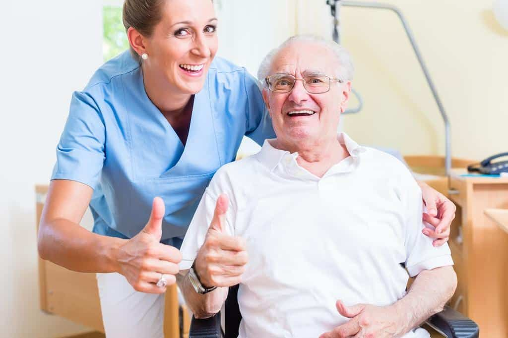 A Certified Nursing Assistant Assists Patients With Activities Of