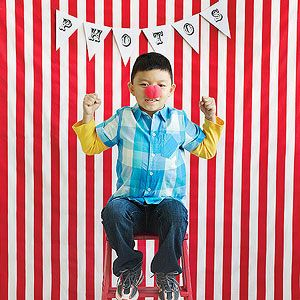 Funny Photo Booth: To let guests grab the spotlight, hang a festive tablecloth to serve as a backdrop. Add a paper banner cut from computer printouts and taped to a string. Snap digital photos of guests posing with a red nose. Print the shots for kids to take home, or use them for thank-you notes.