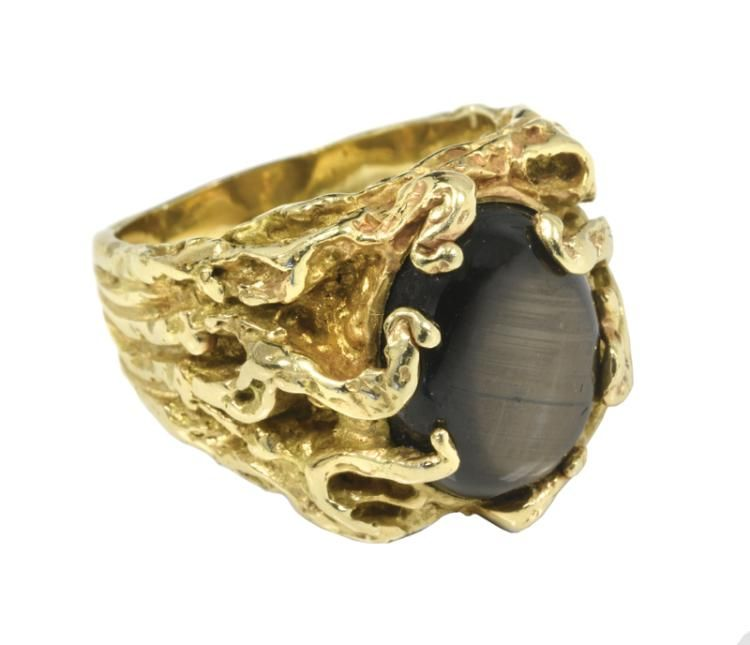 A Men S 14 Karat Gold Ring With Black Star Sapphire Given