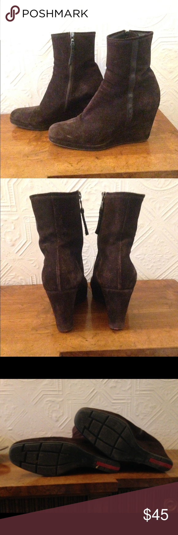 Oldie but goodie Prada wedge booties Haven't worn these in a while but they are still stylish and comfortable. The chocolate brown suede has a nice knap but the picture makes it look pretty weathered. These look great with a dress or jeans. I cannot find the size but I am pretty sure size 40 since that's my size and these fit well. Prada Shoes Ankle Boots & Booties