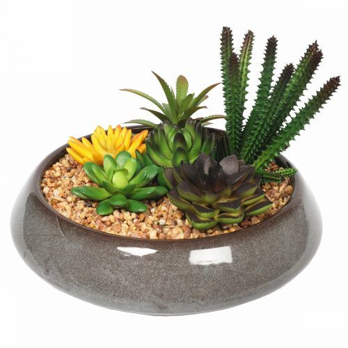 Modern, elegant and life-like this faux succulent bowl is certainly sure to impress. Made with a range of stunning fake succulents this is the perfect choice for a zero-maintenance indoor fake plant that reflects current design trends. #artificialplants #gardening #gardeningtools